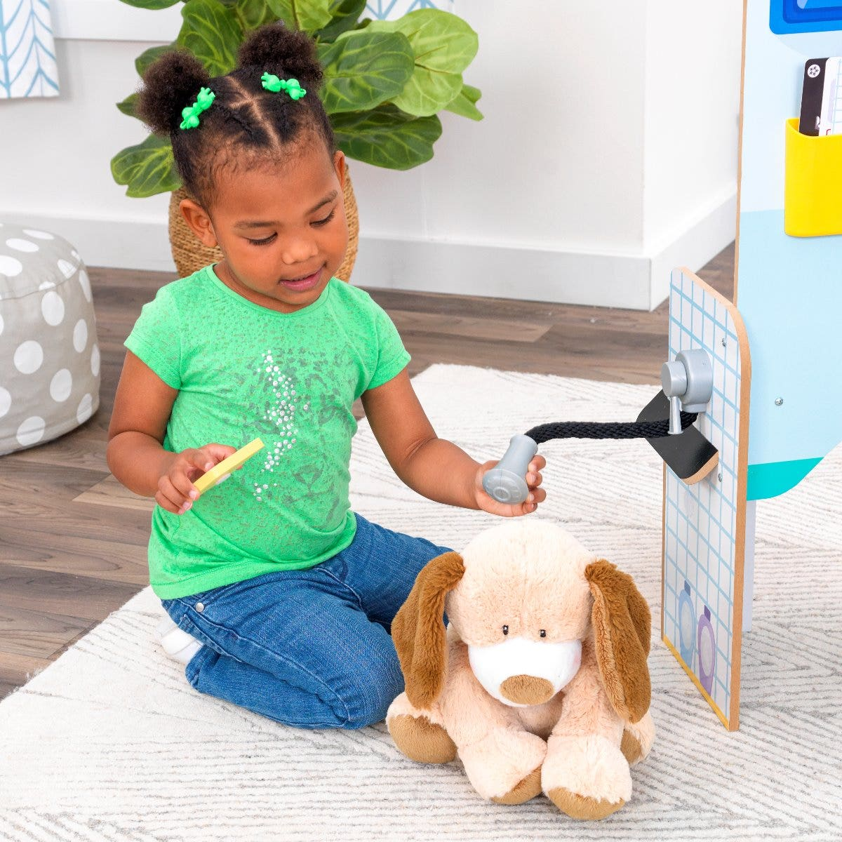 Pampered Pooch: Pets can get all cleaned up at the grooming station. With a removable pretend water nozzle and bar of soap, this area is ready for bubbles of fun.