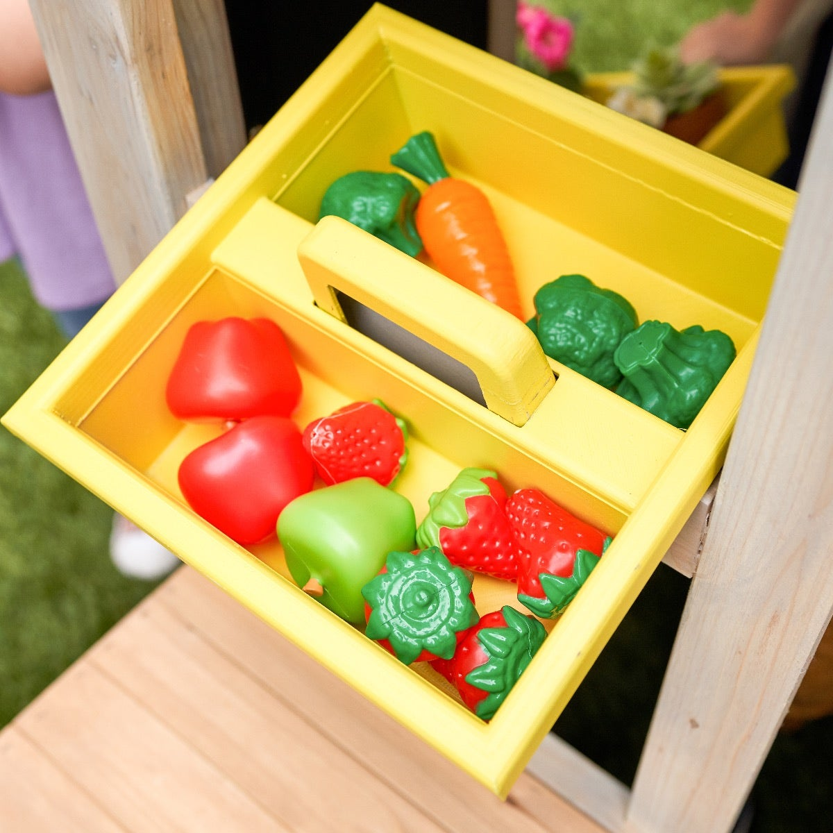 Kids can learn about gardening with the included plastic tote and garden tools
