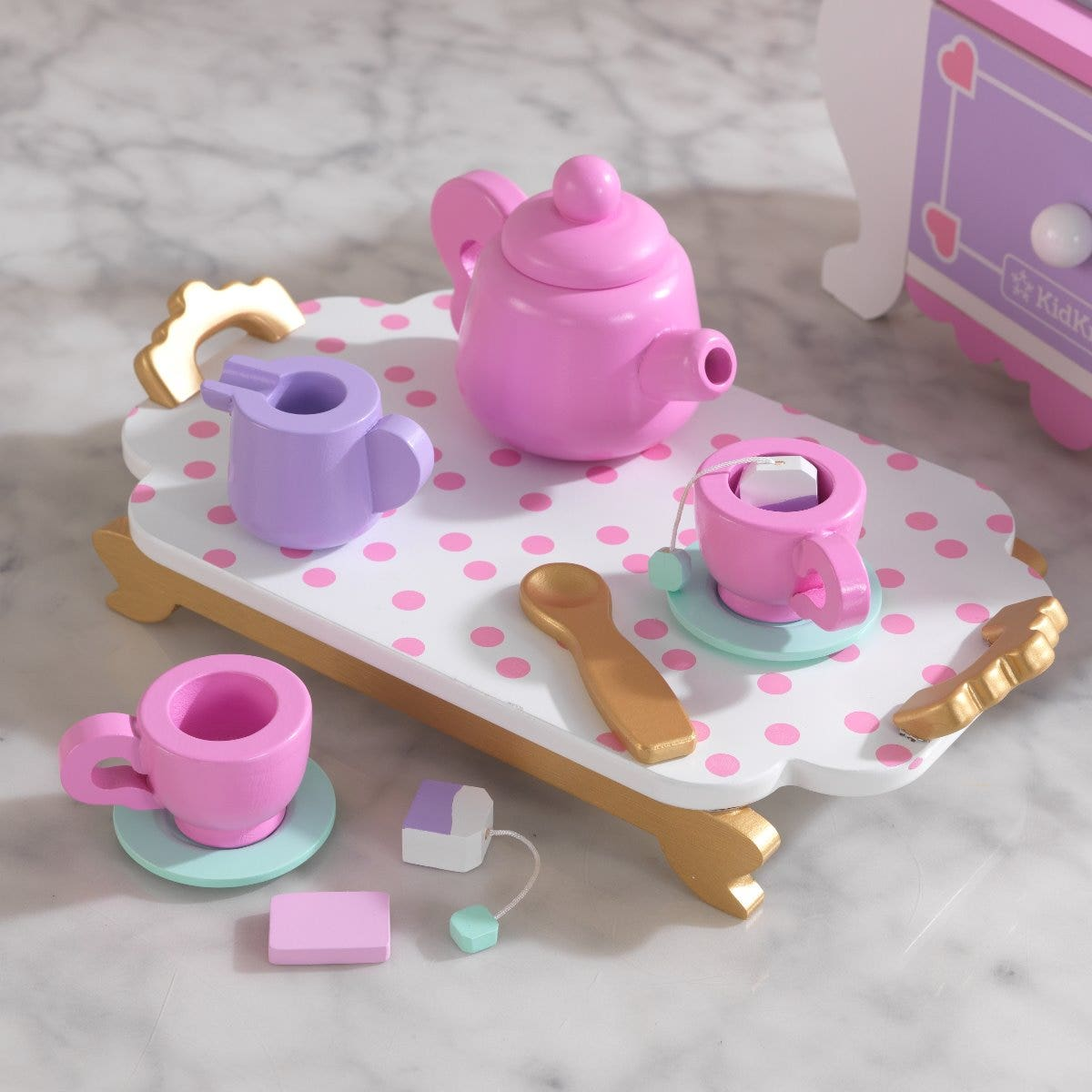 Includes cream, sugar, kettle, serving tray and role-play faucet and burner