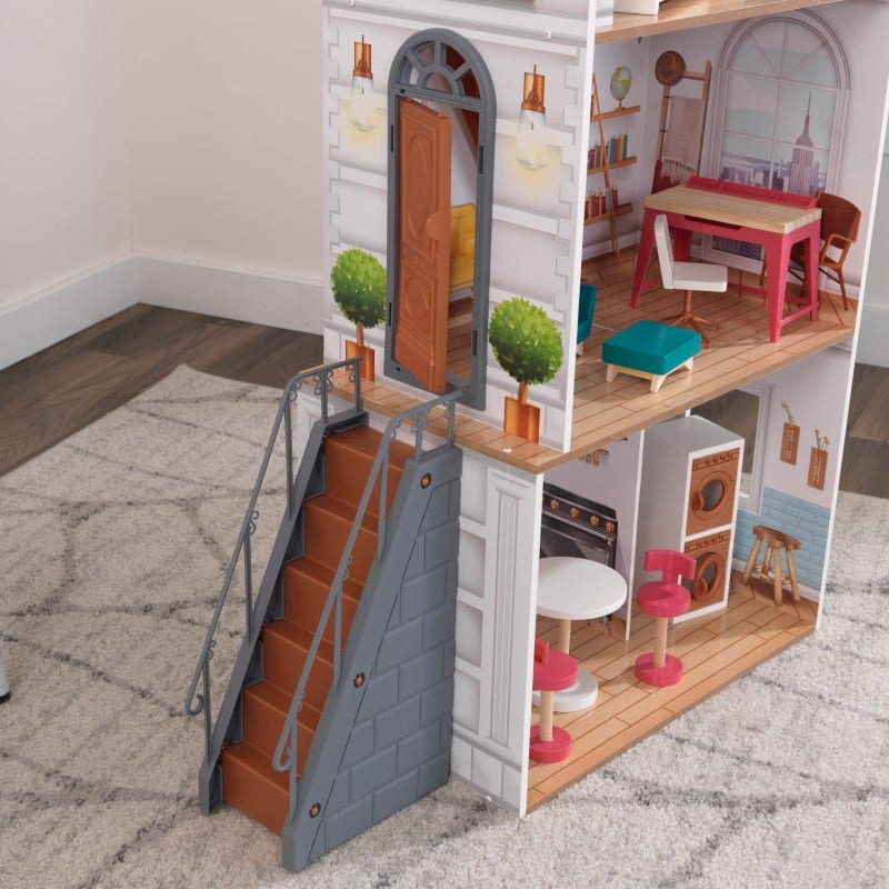 Your child's creativity will soar with the 12-piece furniture kit and movable stairs. Lift the top of the desk to discover storage or open the front door to welcome friendly guests