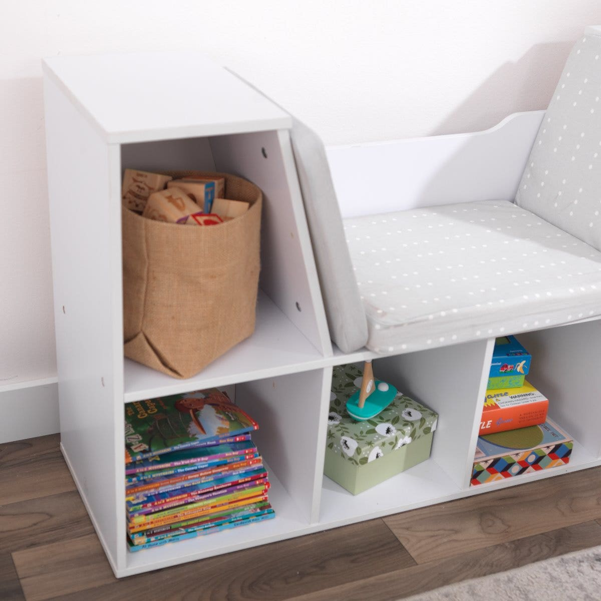 Taller storage space on both sides of the cushion for hard-to-fit items, like picture books