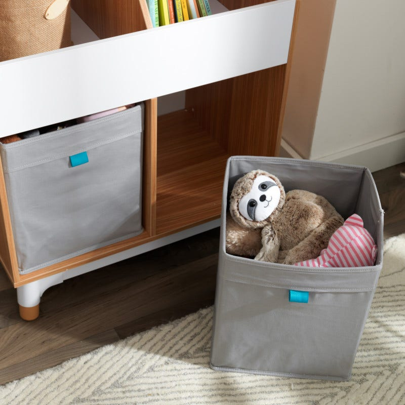 Includes two canvas storage bins