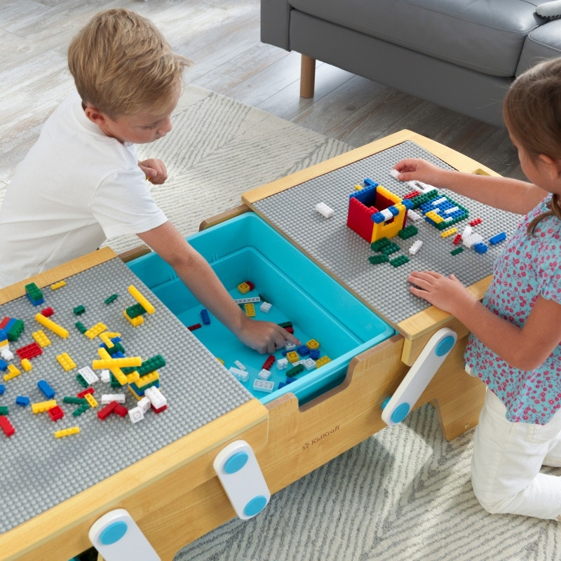Full building brick play table opens to reveal storage space