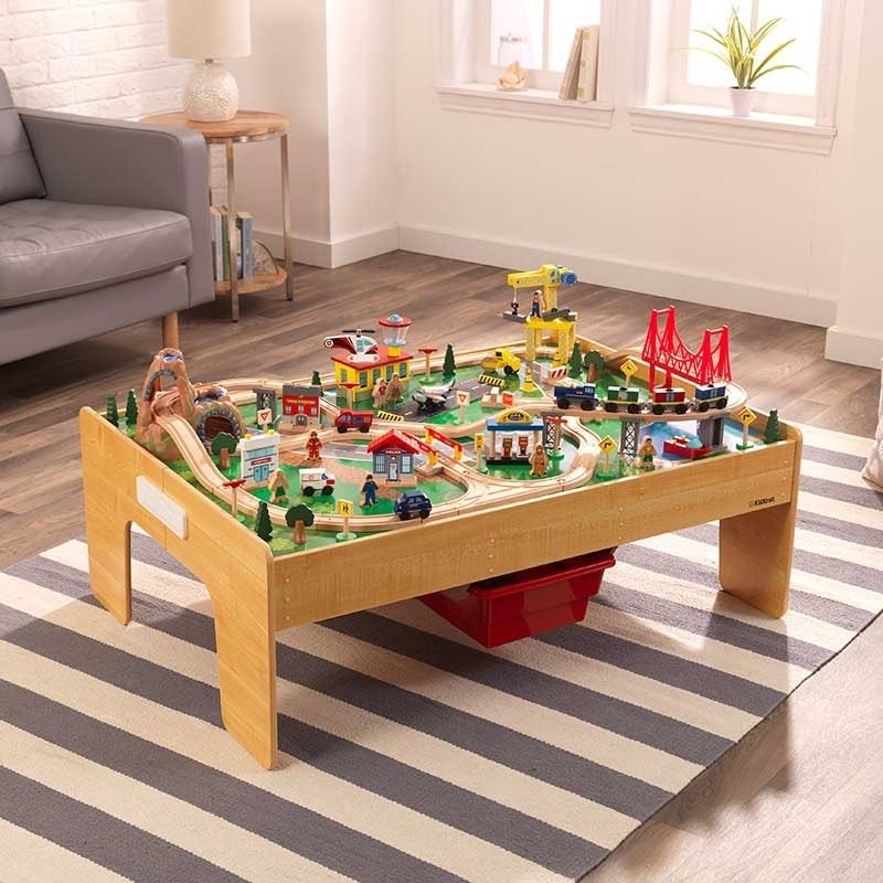 Wooden play table with new folding design allows for quick, easy assembly in under a minute