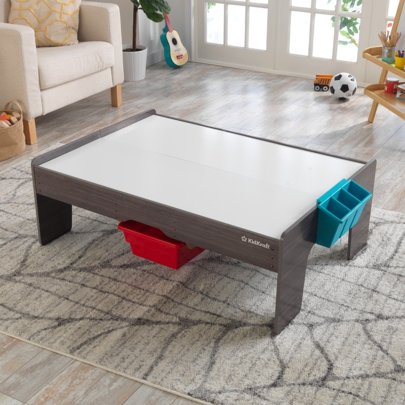 Reversible table top with whiteboard and art caddie