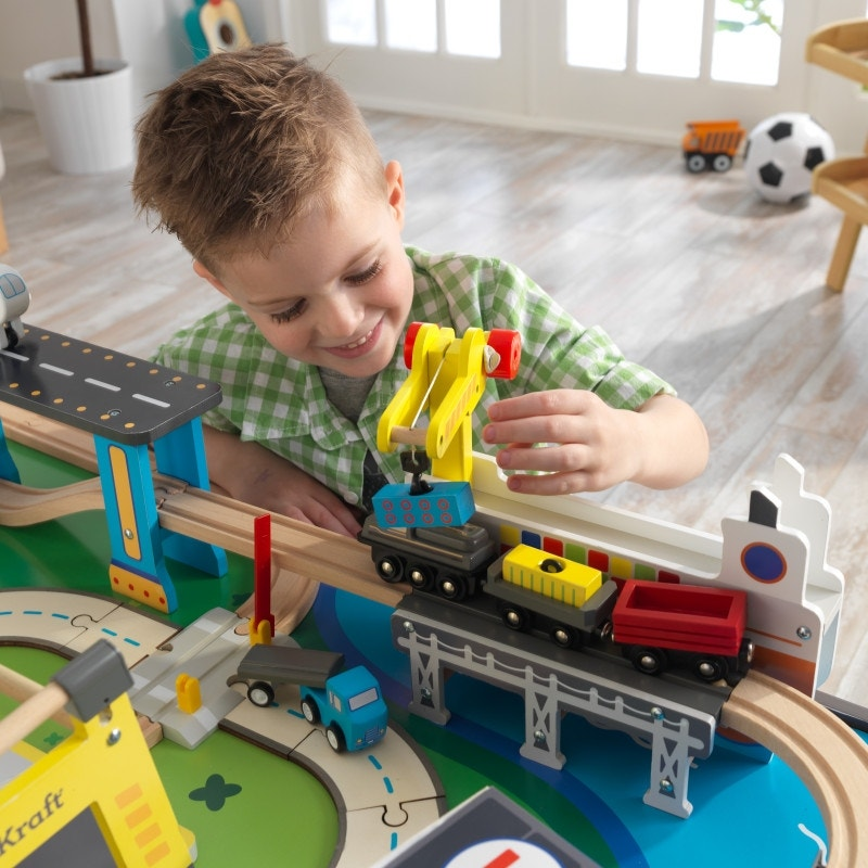 New sleek KidKraft vehicles included: sedan, 18-wheeler, tow truck, fire truck, ambulance, bulldozer, airplane, helicopter, police car, taxi cab, train engine and 2 cargo trains