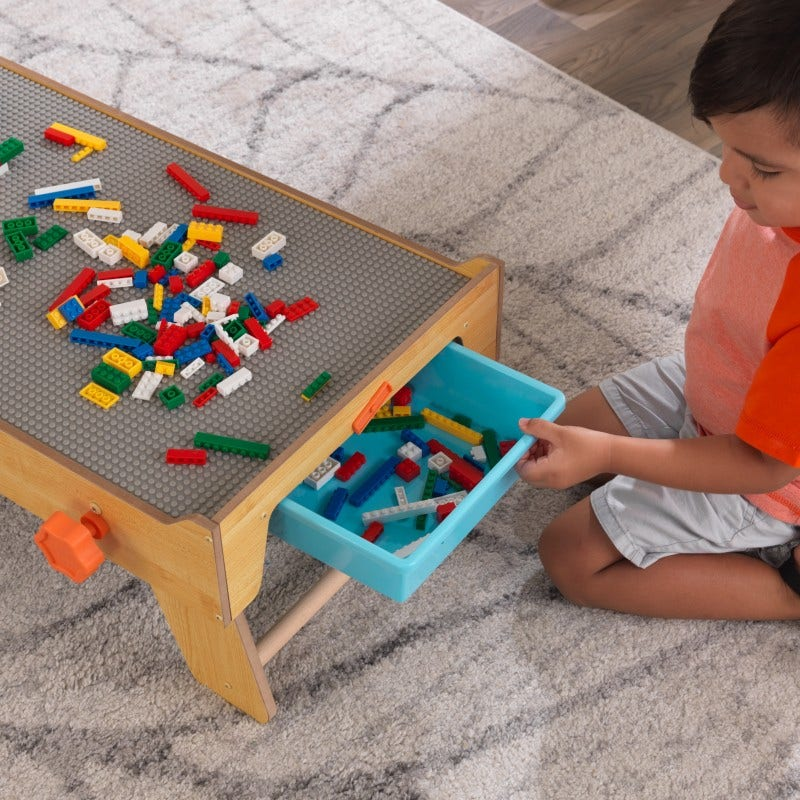 Double-sided storage bins hold bricks for easy, clean fun during and after play