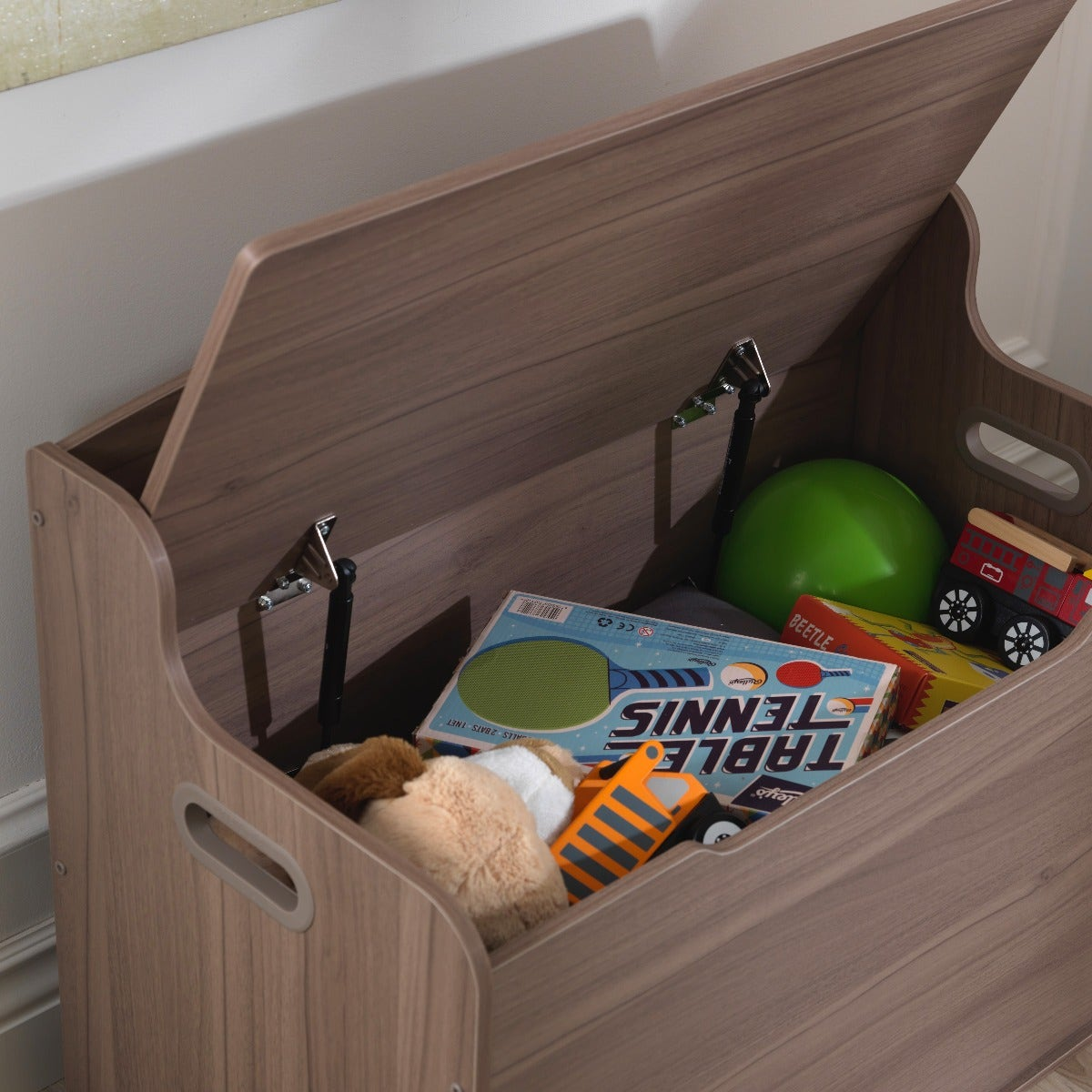 Safety hinge keeps lid from dropping and pinching little fingers