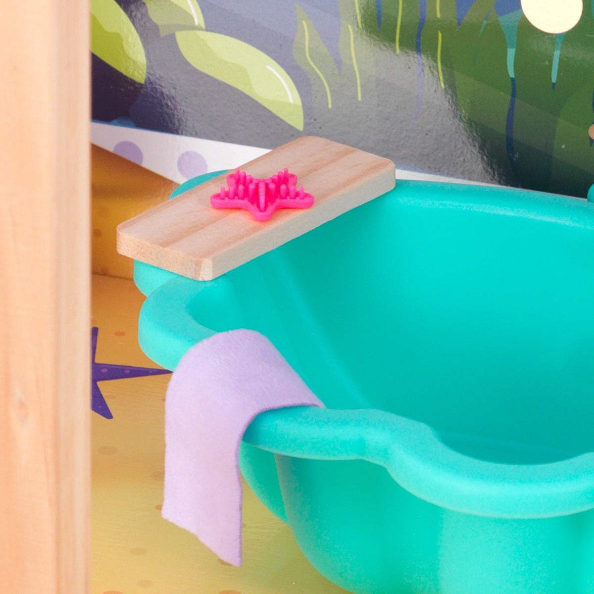 Sea-faring Accessories: Adorable wooden tub tray holds a starfish-shaped comb and fabric towel for realistic interactive play.