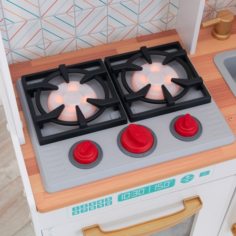 Gas range stovetop with realistic cooking sounds and fire-inspired lights