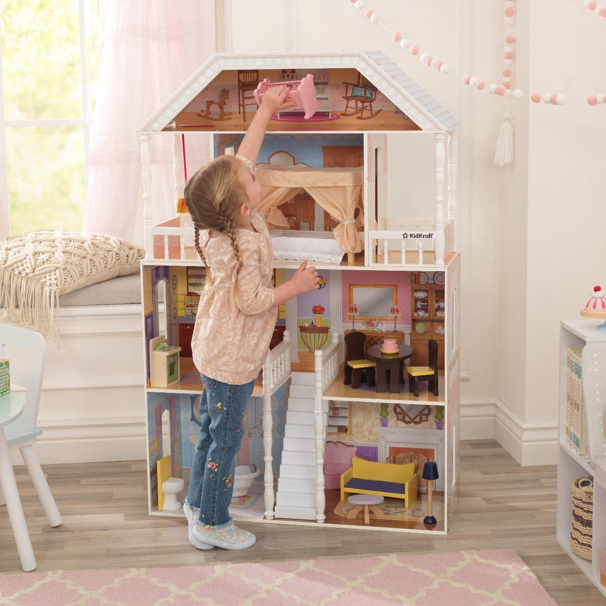 This spacious dollhouse is a child's dream home offering 4 floors, 6 rooms, 2 balconies and a working porch swing. This play set stands at 124.46cm tall and is made from sturdy wood