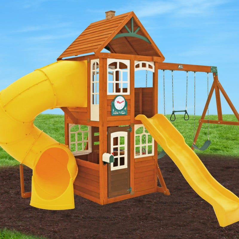 Two level wooden clubhouse with shiplap roof, windows with decorative plastic frames and adorable chimney