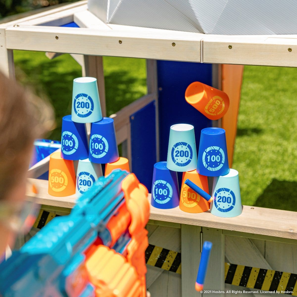 Take Aim: Practice with spinning targets and stackable cups.