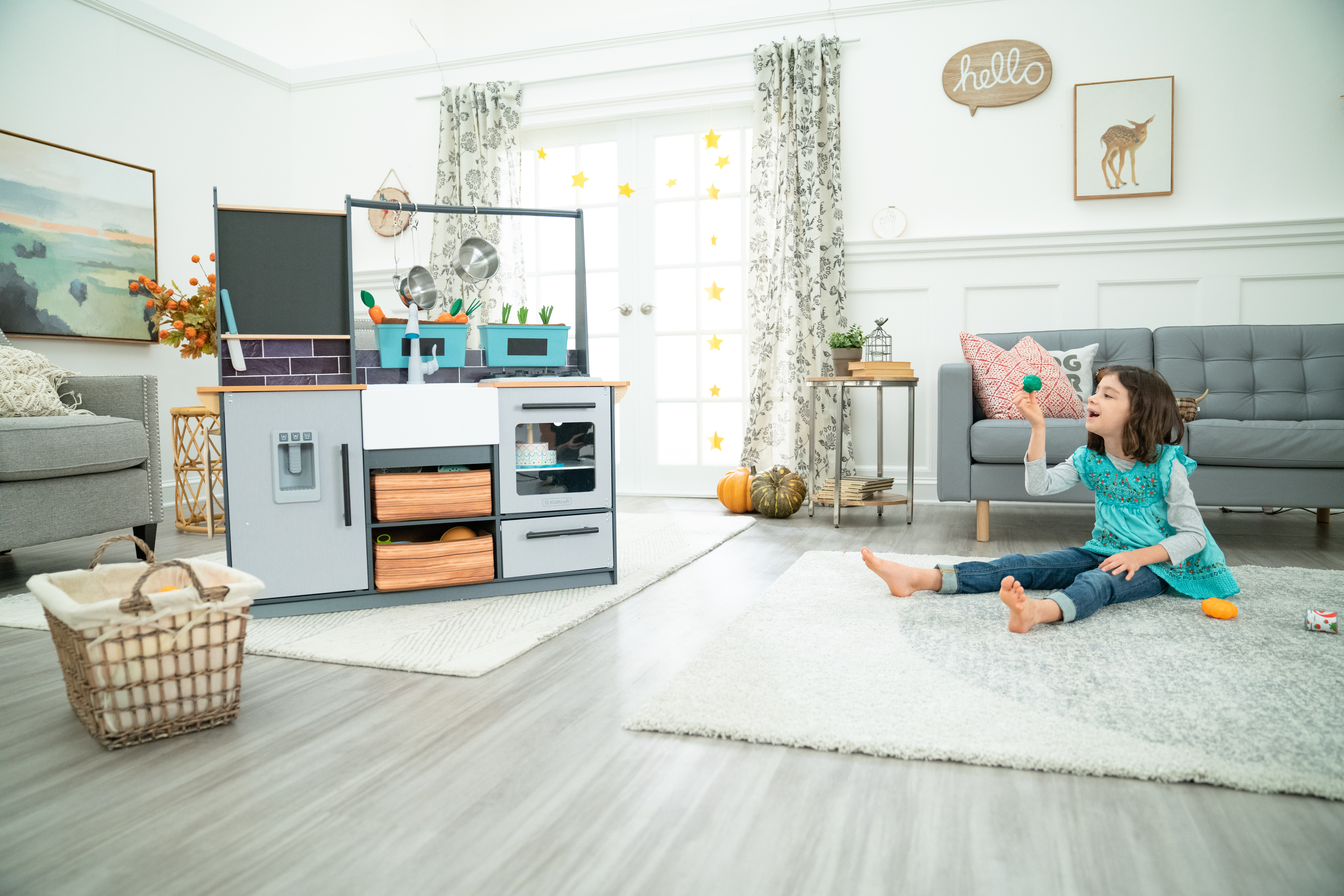 Girl playing with play kitchen accessories