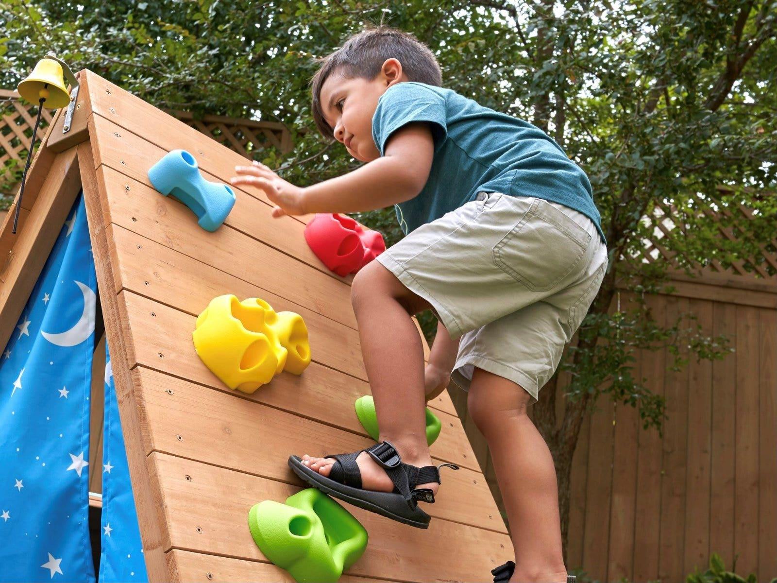 Child climbing up KidKraft outdoor climber