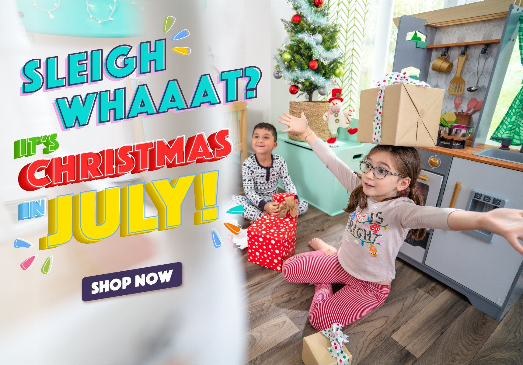kids playing with KidKraft play kitchen with holiday decorations