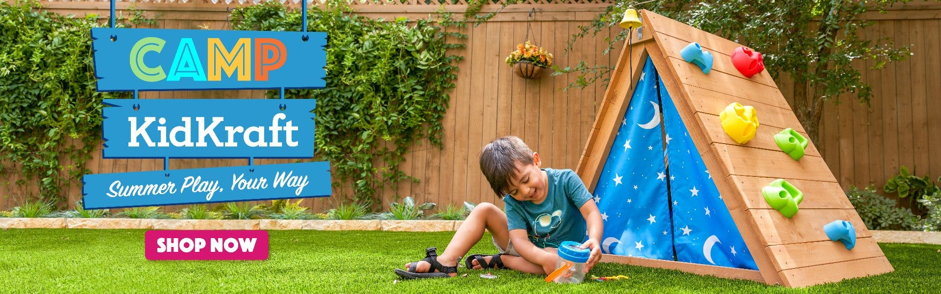 boy playing outside with KidKraft outdoor climber