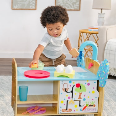 Boy playing with KidKraft Elephant Cooking Play Set