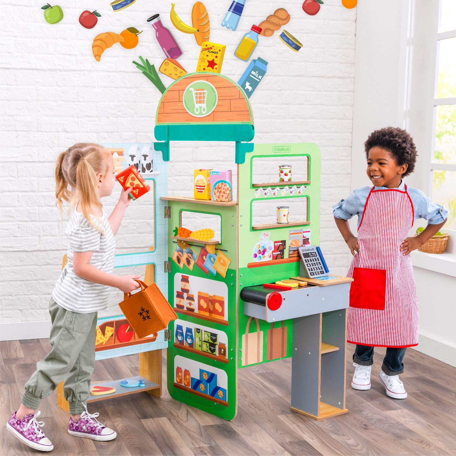 Mother and girl playing with KidKraft Grocery Store Pop Up